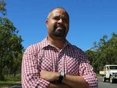 A CAIRNS woman has been charged over allegedly trying to extort money from controversial Queensland MP Billy Gordon.