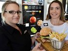 BESPOKE BURGER: Lucy Bidmade, 16, (right) tests out the new system with the help of area manager Rome Leopold.
