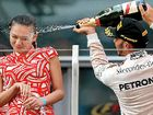 THE Chinese hostess sprayed in the face with champagne by F1 winner Lewis Hamilton says media reports the incident was sexist bullying are over the top.