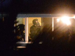 RAID: SERT officers raid a home in Lawrence St in Gympie.
