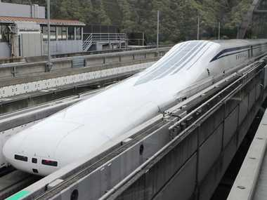 The seven-car maglevtrain returns to the station after setting a new world speed record in a test run near Mount Fuji, clocking more than 600 kilometres (373 miles) an hour