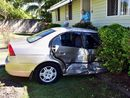 A CAR has crashed into a Tewantin home this morning.