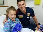 PLAYERS from the Brisbane Lions dropped in to Ipswich Hospital on Friday to meet children in the Sunshine Ward and were mobbed by a few parents as well.