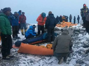 In this Sunday, April 26, 2015 photo, people critically injured in an avalanche are wrapped to be evacuated out of Everest Base Camp, Nepal. An avalanche on Saturday, set off by the massive earthquake that struck Nepal, left more than a dozen people dead and dozens more injured.