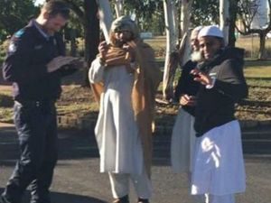"""This photo being circulated on Facebook shows Sergeant Ben Wiltshire from Miles Police conversing with three Muslim visitors. Sgt Wiltshire said it was """"disappointing"""" members of the community had jumped to conclusions about their motives. Photo: Facebook"""