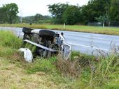 A UTE rollover near the entrance to the Amberley RAAF Base has triggered a chaotic morning on the Cuningham Highway.