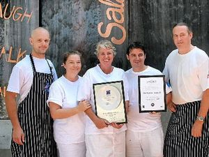 AWARD WINNING: The friendly team at Salsa Bar & Grill show off two of their many hospitality awards.