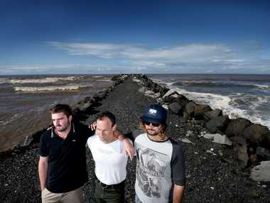 Ballina locals Shayne O'Neill, Kirk Trease and Mitch Langjumped into the water to save a father and his child at South Ballina Wall after a rogue wave dragged the family along the wall.