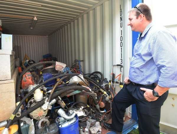 Detective Senior Constable Neal Whitmee with some of the items found on a Struck Oil property. Photo Allan Reinikka / The Morning Bulletin