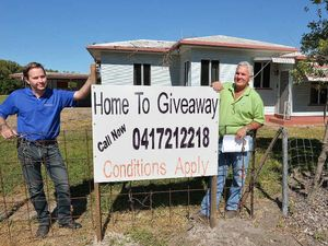 Building Supervisor Philip Whitmore left and Builder Stephen Challen with the home they are giving away.