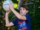 YOUNG Beau Scott is trying his best to get through some tight hoops to reach his goal...of playing netball.