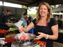 Sarah Kinneally weighs some tomatoes at the Murwillumbah farmers markets. Photo: John Gass / Tweed Daily News