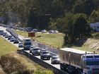 TRAFFIC was brought to a standstill on the Cunningham Highway on Monday morning when a truck carrying a house was unable to squeeze through roadworks.