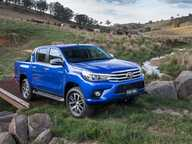 WEARING more elegant styling cues and promising more car-like driving characteristics, Australia got its first look at the new Toyota HiLux ute today.