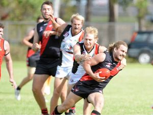 FULL SPEED: Hervey Bay Bomber Jake Nagy slips away from the Brothers Bulldogs defence in the senior AFL game at Brothers Sports Club earlier this season. Bombers were thumped by 94 points.