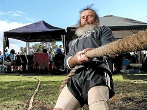 DIGGING IN: Tug of war veteran Glen Hoffman, 59, of Maitland takes a firm grasp in the Beef Meets Reef tug of war championships in Evans Head.