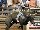 RIGHT: Karem Dunne rides his bull Midnite Special, during a rodeo event.