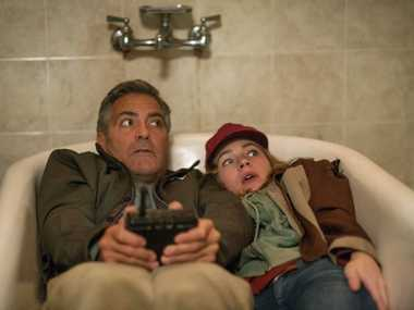 George Clooney and Britt Robertson in a scene from Tomorrowland.