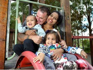 FREE AT LAST: Dusan Jacenko reunited with his wife Thushari and children, Jazz, 3, and Jayden, 2.