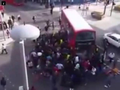 WATCH: Crowd lifts double-decker bus off trapped unicyclist