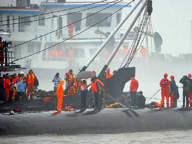 GRIM TASK: Rescue workers and divers prepare to search for survivors following the capsize of the Eastern Star in the Yangtze River.