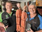 A CHEF-LIKE approach to creating sausages has earned Warana butchers Paul Rae and Rob Glenny the regal title of snag royalty.