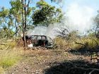 CAR BLAZE: Fabian Spice puts out the last of the flames which engulfed a car in the Byfield National Park.