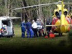 FATALLY INJURED: The microlight pilot after being freed from the wreckage of his plane at Tyagarah, near Byron Bay. He died a short time later at the Gold Coast University Hospital.