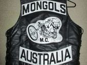 A GLADSTONE woman whose life was allegedly threatened by a Mongols gang member has been kept in jail to stop her fleeing for her safety.