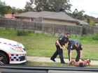 This is an image of Goodna assault accused Ariik Mayot being detained by police on Monday afternoon. Photo: Contributed