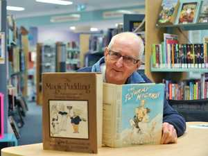 "Neil Glover of Maleny and collector of rare Australian Books will have an exhibition of his books at the Maleny Library during the upcoming celebration of books. He is photographed with his fist edition books titled, ""The Magic Pudding"" The adventures of Bunyip Bluegum. Written and Illustrated by Norman Lindsay and ""The Flyaway Highway"" by Norman Lindsay. Photo Greg Miller / Sunshine Coast Daily"