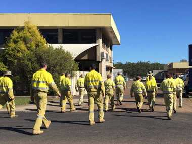 INDUSTRIAL ACTION: Ergon staff return to their Maryborough depot yesterday after only doing emergency work.