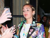 MILEY Cyrus has been pictured kissing her rumoured girlfriend Stella Maxwell in a car park in Hollywood.