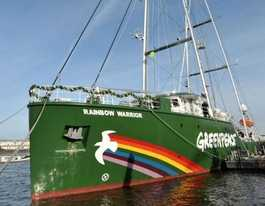Green warriors ride in on rainbow to protect our golden reef