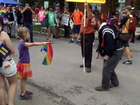 Girl confronts hate preacher with a simple pro-LGBT gesture