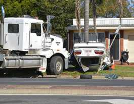 Man critical after truck and car collide in Toowoomba