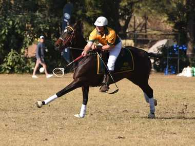 Tansey player Trent Collins plays for Australia in the Polocrosse World Cup in Shongweni, South Africa. Photo Libby Wells