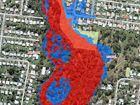 Suncorp concedes defeat after flood maps clear Rocky home