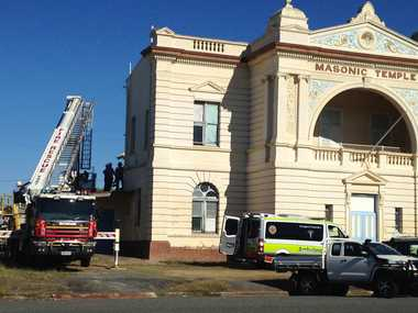A 65-year-old man has fallen 8 metres after a ladder he was on slipped away at the Masonic Temple in Kent St.