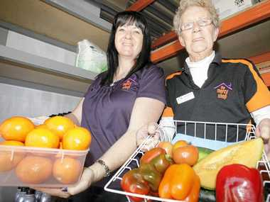 HELPING HANDS: Transformation Centre manager Beth O'Donnell with Bribie Storehouse volunteer Margaret O'Donnell.