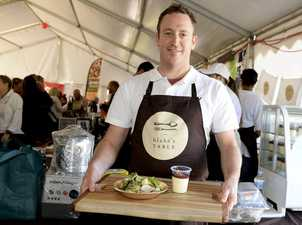 RSL excecutive Chef Blake Seymour, with a plate of Balinese Pork curry and butter milk Panna Cotta at the Ballina Food and Wine festival. Photo Mireille Merlet-Shaw / Northern Star