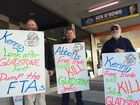 UNION members are this morning protesting in Gladstone over the signing of a free trade agreement with China.