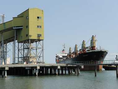 BIG BERTHA: Tugboats manoeuvre the massive 170m long CSL Atlantic sugar transport ship into Bundaberg Port to pick up the first large load of sugar for the season. Photo: Max Fleet/NewsMail