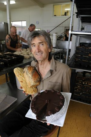 Geoff Haycraft owner of Goanna Bakery and Cafe with bakers in the background from left Patrick Stead and Sridharma.