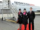 TOUCH DOWN: The Flying Kangaroo Qantas bounds into the Sunshine Coast, with cabin crew Natalie Quayle, Grace Coffee and Alexander Barns.