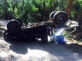 A SUNSHINE Coast couple has walked away from a  mangled car wreck after a rollover on a sandy road north of the region.