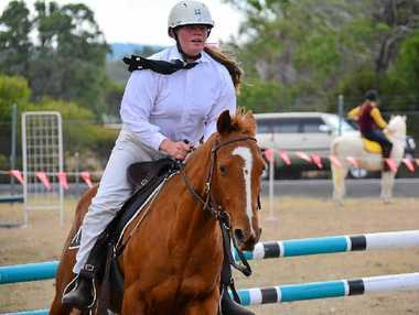 RIDE RELIEF: Nanango Pony Club's Brook Smith neatly clears the final jump.