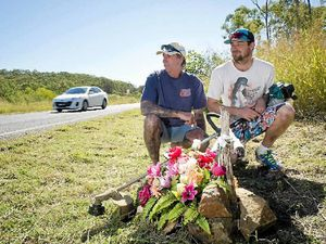 Greg Harding and Shaun Reynolds at a roadside memorial for their friend, Graeme Walker, who died in an accident along Gladstone Benaraby Rd in January.