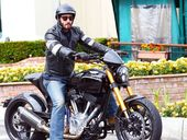 KEANU Reeves fans can go on a motorbike ride with him - for $150,000, but they get to keep the bike he designs afterwards.