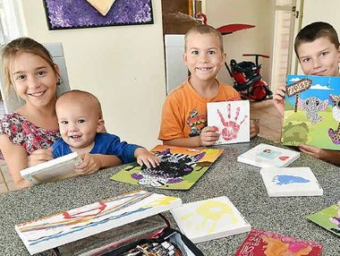 CREATIVE WITH CENTS: Tangikara children get crafty – Larissa, 10, Kaiden, 1, Deacon, 7, Lachlan, 11 and Tyler, 5.